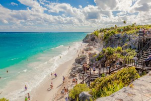 Tourist and vacationers enjoying time at the Tulum Ruins Beach.