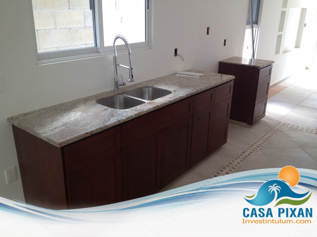 kitchen counter with the sink installed. Opening is for the stove.